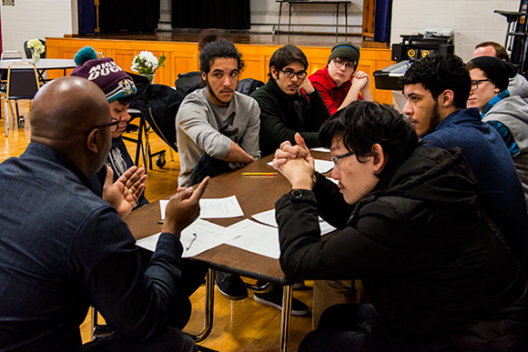 A group of Pathways students in Ann Arbor gather in discussion.