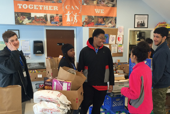 Pathways students taking part in a community service project sponsored by the Community Action Network held at the Bryant Community Center.
