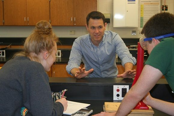 Physics teacher Brian Langley explains a lab experiment to students.