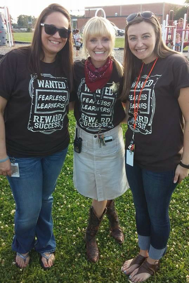 (Left to right) Lindsey Harris, reading interventionist; Melissa Usiak, principal and Amanda Harris, kindergarten teacher at Sycamore Elementary, stop for a quick pic while canvassing.